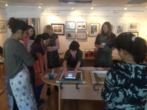 Participants on Belfast Print Workshop programme Imprint start to print images for Culture Night Belfast 2014 in the John Luke Gallery